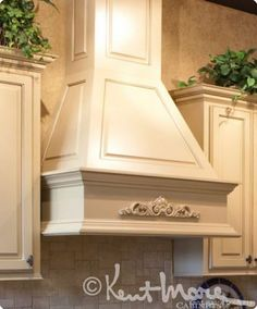Custom curved drywall hood with corbels painted to match