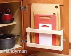 Attach a cutting board rack to the back of cabinet.