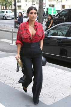 Kim Kardashian took a break from her very busy schedule as North West's Fashion Week handler to run some quick errands at Lanvin. In deference to the changing seasons, Kim opted for a notably cozy and casual off-duty look, pairing a loose red-plaid flannel (perhaps borrowed from Kanye's closet?) with very wide-legged black slacks.