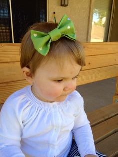Green with silver hearts bow headband. Available at www.etsy.com/shop/thelittlebowco