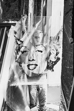 Andy take my picture. Warhol holding up a transparency from which he makes the silkscreen of MM.