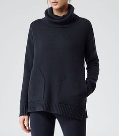 Relaxed fit with fun roll neck and patch pockets.