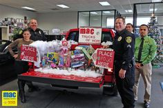 Holiday food and toy donations with the Madera Police Department at the dealership last year.