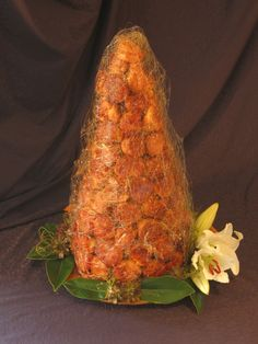 The traditional croquembouche. A french wedding cake made of puff pastry, filled with sweet, cream custard.