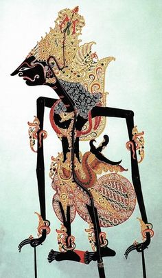 Indonesian shadow puppets. I grew up with these in my house. It would be a nice personal touch to feature one if it fits with the aesthetic.