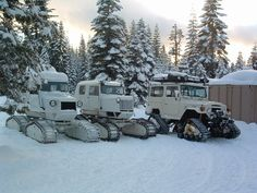Two Tucker Sno Cats and Land Rover on Mattracks. that rover looks dope as fuck