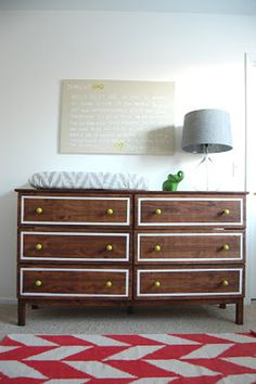 Geometric takes a different turn with this classy wood dresser with neon green drawer pulls, the ultimate accent to the painted gray lines.