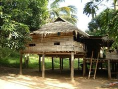 Traditional rural Thai house with thached roof and weaved bambo wall, Thailand - Traditional Homes Across the World