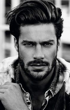 Stop shaving. Let your stubble grow to the point of being a short beard.