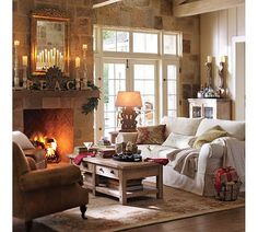 love this room, love everything about it...the fireplace, the rock mixed in with the wood, furnishings and the lighting. Can I go sit down?