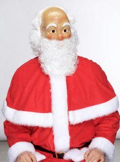 Joulupukin naamari parralla