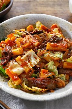 This popular street-food dish, called tteokbokki, is a garlicky, richly spiced dish of rice cakes bathed in red chile paste Tteokbokki (pronounced duck-bo-key) got its own festival, spinning off from the larger annual Seoul festival of rice cakes, or tteok.