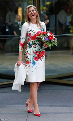 The red and white flowers in her bouquet coordinated perfectly with the print on her dress