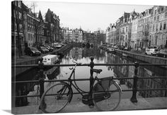 Black and white imge of an old bicycle by the Singel canal, Amsterdam, Netherlands