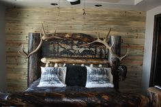 Log bed with antler and metal cutout panel