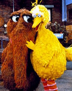 Mr. Snuffleupagus and big bird.  Okay, so not totally 80's, but growing up Snuffy was my favorite character on Sesame Street