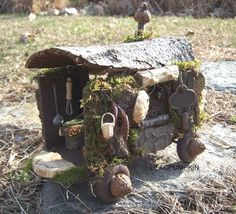 Fairy caravan - inspiration only, but I love all the natural materials used here - a bit of bark or tree round for roof, acorns for wheel hubs, etc. - great detail and by the size of the key obviously very tiny - well done!   ************************************************  Etsy found via Google - #fairy #garden #caravan t√