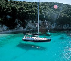 Our luxurious Beneteau 52 'Kalokeri' anchored just off Anti Paxos...
