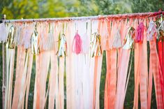 colorful ombre ribbon backdrop with tissue tassels