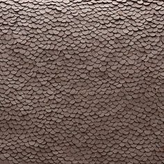 """Detail of Leather Sequins on """"Oversized Leather Sequins Clutch"""" from Cuyana."""