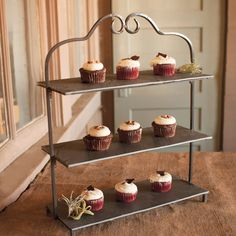 Appetizers and desserts look equally delicious displayed on this charming tiered wrought iron stand. The slate tiers give you space to label your goodies—or let your taste buds do the work