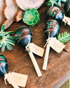 Guatemalan maracas served as escort cards, dance floor props, and favors.