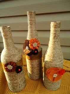 Diy twine and fabric flowers wine bottle crafts - table decoration, wedding centerpieces - LoveItSoMuch.com