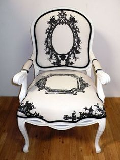 White painted French Provençale side chair in graphics of black antique frames with black piping.