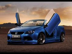 Hot Blue Volkswagen EOS with nice Body Kit and Lambo Doors