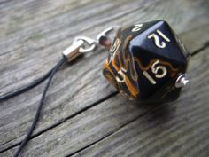 D20 dice cell phone charm toxic orange polyhedral dice accessory dungeons and dragons rpg. $12.00, via Etsy.