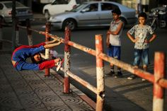 02.06.2016 - GAZA CITY, PALESTINIAN TERRITORIES: Palestinian boy Mohamad al-Sheikh, 12, who is nicknamed 'Spiderman' and hopes to break the Guinness world records with his bizarre feats of contortion, demonstrates acrobatics skills