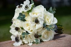 White rose and white anemone created this back and white themed wedding bouquet by Reynolds Treasures