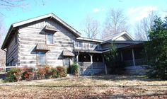 Less than 10 miles from the Trace, with 67 acres of trails and views in all directions. Cedar log home, with porches everywhere, has guest room, as well as a honeymoon suite with bedroom, sitting room and jacuzzi. Separate guest house has three more guest rooms, two baths, kitchen.