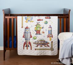Give a beautiful, one-of-a-kind gift to the new little love in your life with hand-stitched quilts and other nursery accessories!