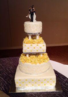 Four tier white & yellow Wedding Cake