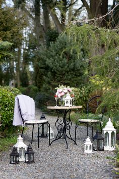 This wrought iron furniture immediately conjures images of charming French cafes and enchanting Victorian greenhouses. Create your own corner in your garden with a cluster of lanterns for that cosy glow as the sun goes down.