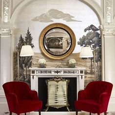 Fornasetti wall and elegant royal red seating. The most classic seating area.