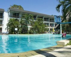 Travellers Beach Hotel -is situated 11 kms north of Mombasa overlooking the Indian Ocean.   The 150 bedrooms are all air-conditioned with ensuite bathroom and sea facing verandah. Starting as a stream in the Reception Area, a 220 foot long freeform terraced swimming pool runs down into the gardens over a series of mini water slides. Mombasa, Recreational Activities, North Coast, Reception Areas, Water Slides, Beach Hotels, All Over The World, Night Life, Terrace