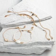 One of my favorite discoveries at WorldMarket.com: Gold and Pink Bracelet Set of 4
