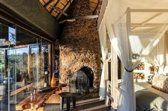 Singita Boulders is a luxury South African safari lodge. Singita Boulders Lodge is located in the game-rich Sabi Sand Game Reserve and offers 12 stylish villas. Boulder Hotels, Boulder Lodge, Lodge Bedroom, Sand Game, Safari, Game Lodge, Game Reserve, Luxury Holidays, Bouldering