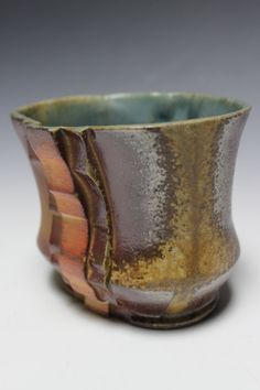 Ceramic stoneware cup with wood fired blue glaze by YoungArts, $30.00