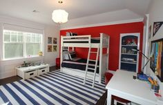 Boys' bedroom in white, red and blue with bunk beds and lovely lighting