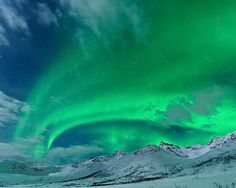 Tromsø, Norway, the solar wind combined with moonlight and snow - January 2011