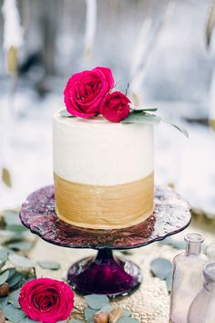 gold and white wedding cake - photo by Sweetlife Photography http://ruffledblog.com/winter-wedding-ideas-with-an-amaranthus-chandelier #weddingcake #cakes