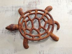A personal favorite from my Etsy shop https://www.etsy.com/listing/505535632/vintage-rusty-cast-iron-turtle-trivet