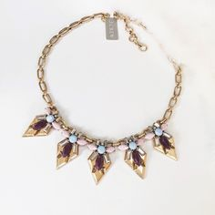 """HP .J.Crew. Jeweled Shield Necklace Nwt Shimmery shield shapes finished with a Deco-inspired mix of jewels? It caught us with our guard down. Steel, zinc, glass, epoxy. Light gold ox plating.                                     Host Pick by  .@burstsoffashion   Size & Fit Details  Length: 17"""" with a 2 1/4"""" extender chain for adjustable length. J. Crew Jewelry Necklaces"""
