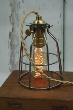 Shop for on Etsy, the place to express your creativity through the buying and selling of handmade and vintage goods. Cage Pendant Light, Cage Light, Steel Cage, Vintage Lighting, Plugs, Vintage Style, Table Lamp, Wire, Unique Jewelry