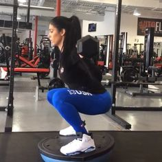 Legs!!! Weighted squats. I do this as part of my leg work out. I use 60 pound bar and Bosu. Great for legs, glutes and abs.