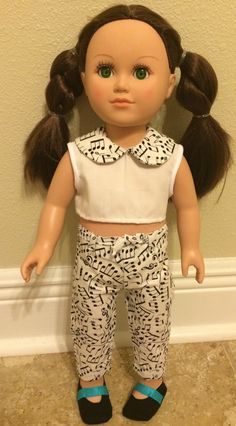 American Girl doll outfit. From the School Girl Collection. Chic, short sleeve, music note crop top with matching long, skinny pants.