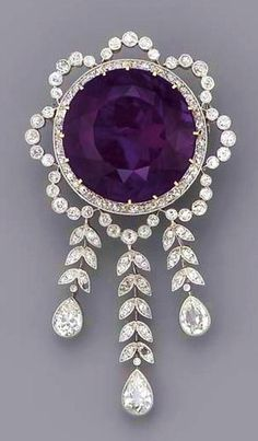 A Belle Epoque Amethyst & Diamond Brooch; circular-cut amethyst within the diamond garland surround, suspending a graduated fringe of diamond leaves to the three pear-shaped drops, millegrain setting, mounted in platinum and gold, circa cm. Purple Jewelry, Amethyst Jewelry, Diamond Jewellery, Gold Jewelry, Gold Necklace, Belle Epoque, Ring Armband, Antique Jewelry, Vintage Jewelry